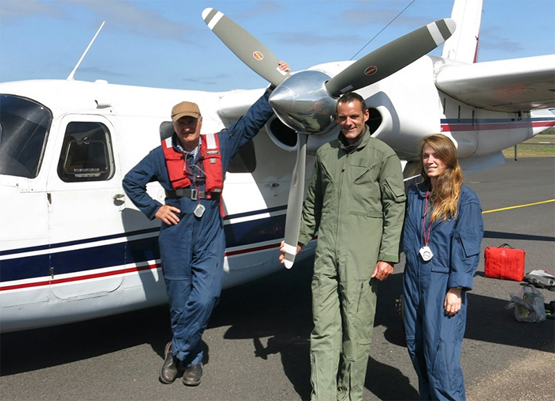 Blue Whale Survey crew (L-R) Dr. Peter Gill and whale observers Vince Antony and Jasmine Bursic (Deaking University Marine Science student) standing in front of the  Aero Commander 500 Aircraft used for the survey.