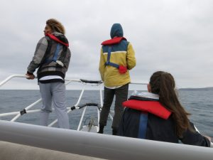 Students Braiden Malady, Jack Caithness and Caitlyn Billington search for blue whales aboard 'Bonney Blue'